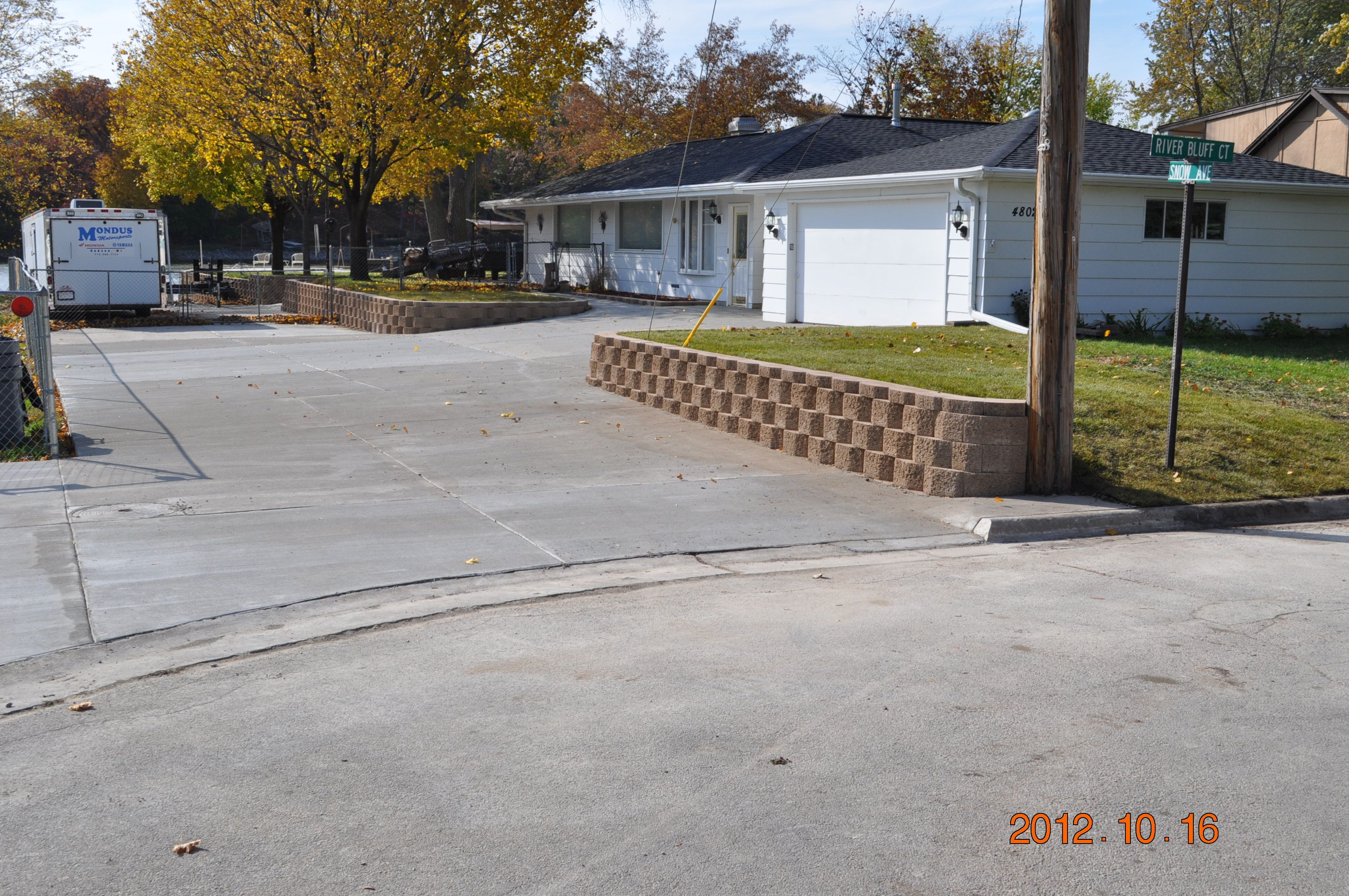 Smaller retaining walls like this one help to support slopes and level off yards.