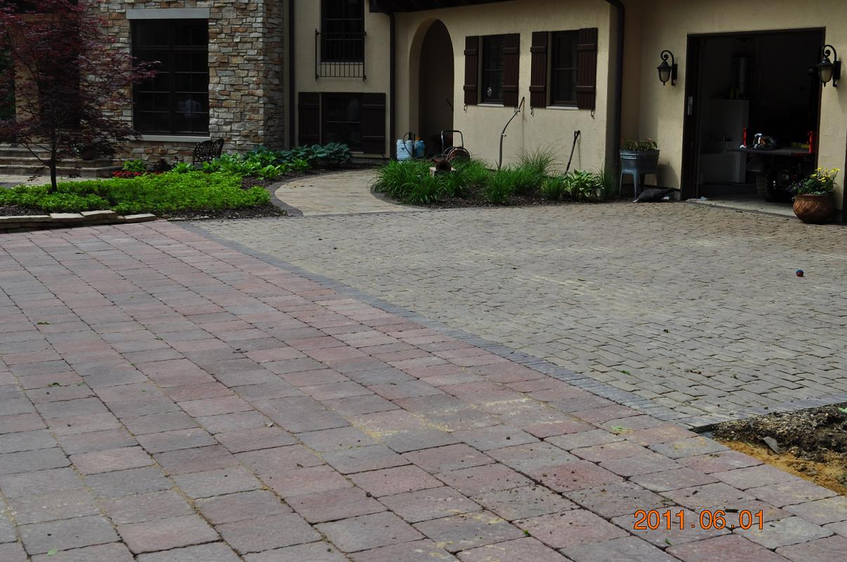 We specialize in all types of hardscape construction, including paver driveways like this one.