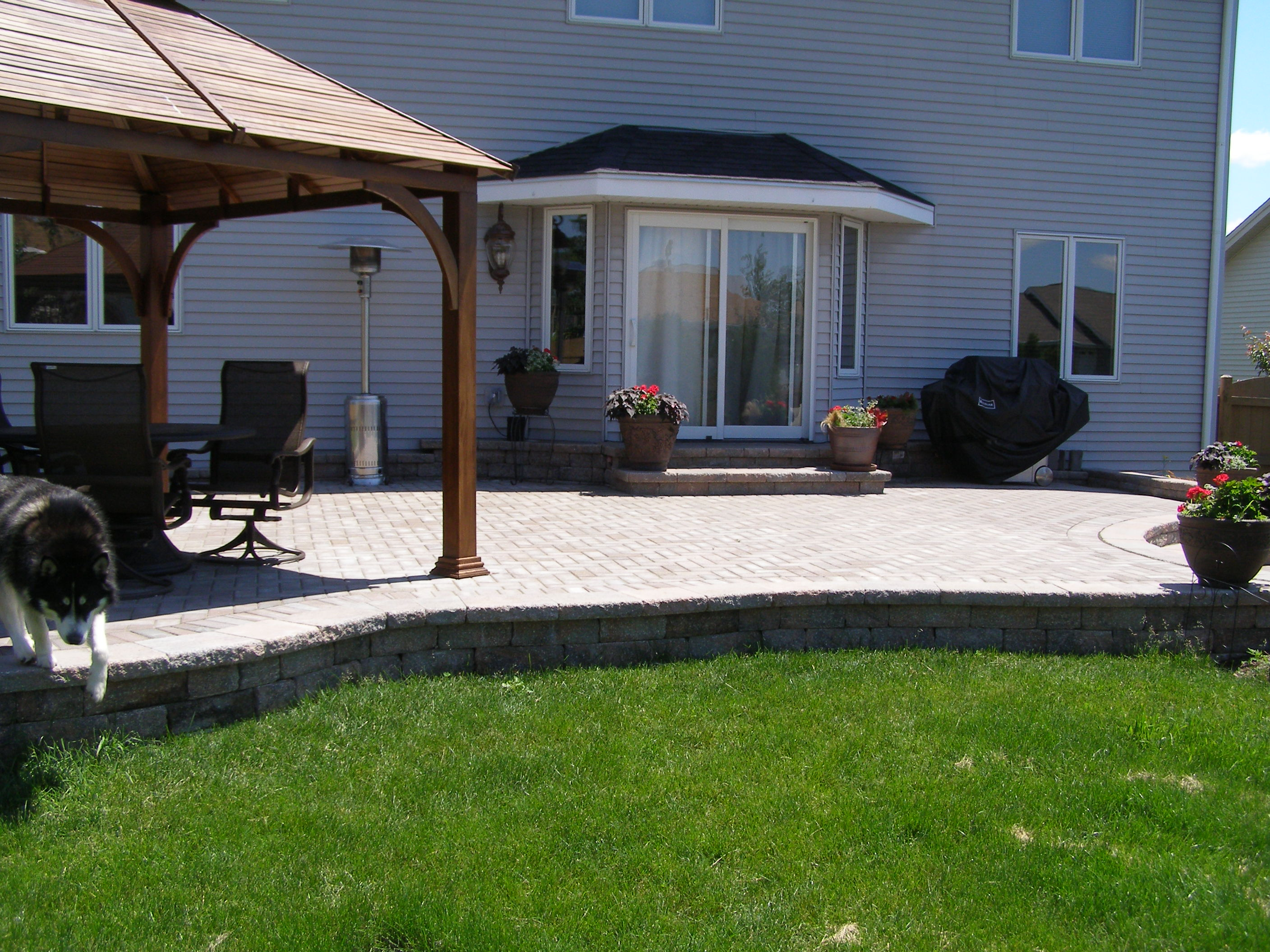 This Rockford patio is complete with a shade structure for outdoor entertaining.