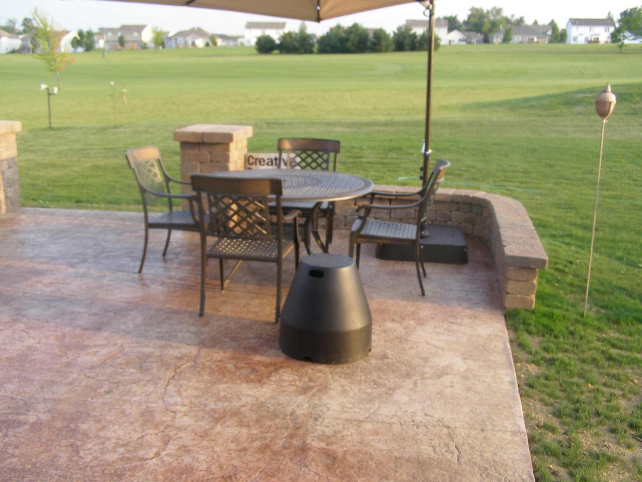 Seat walls can add extra space for entertaining to your Rockford patio.