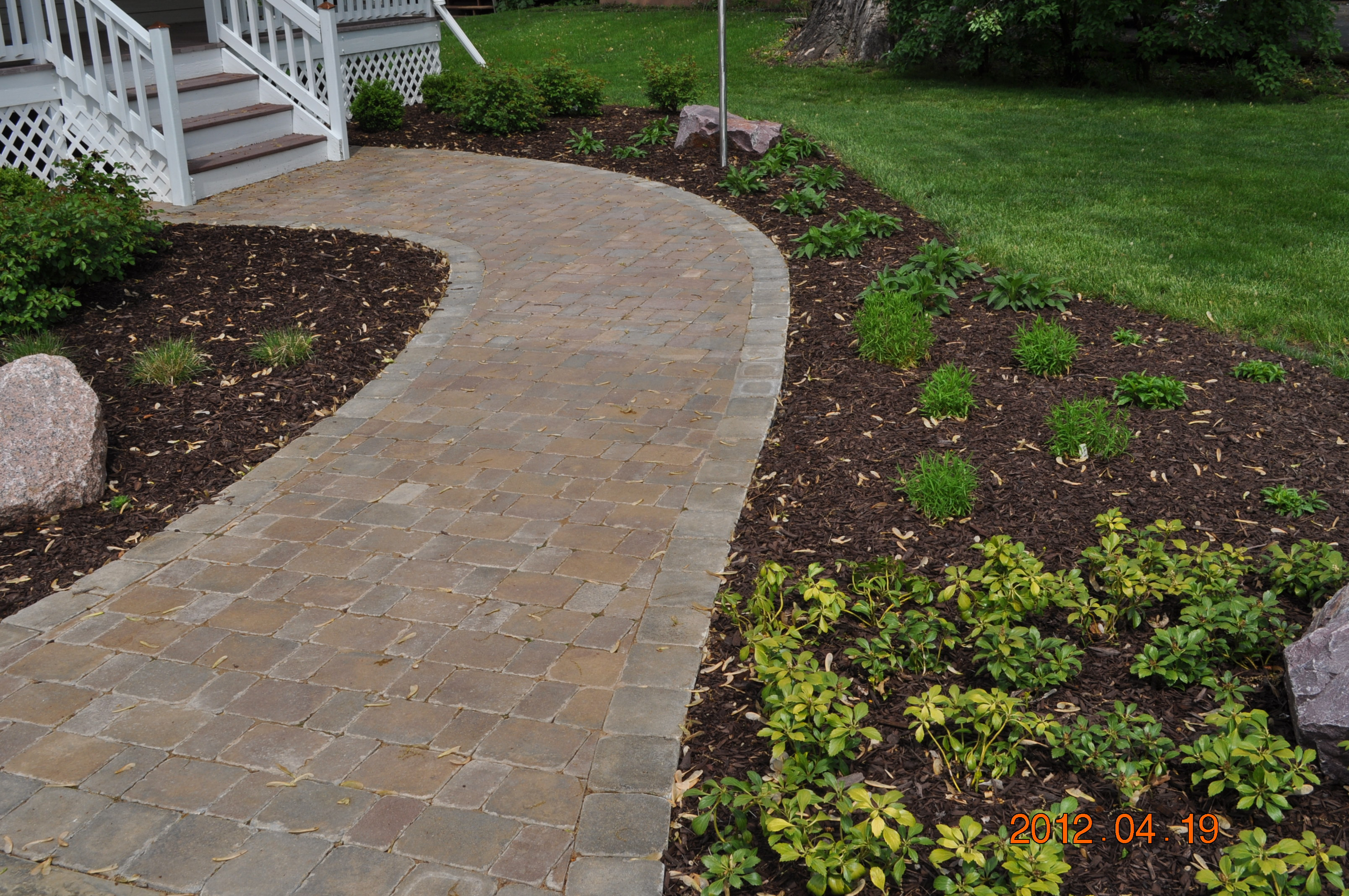 A stamped concrete walkway leading up to the front entrance of a Rockford home.