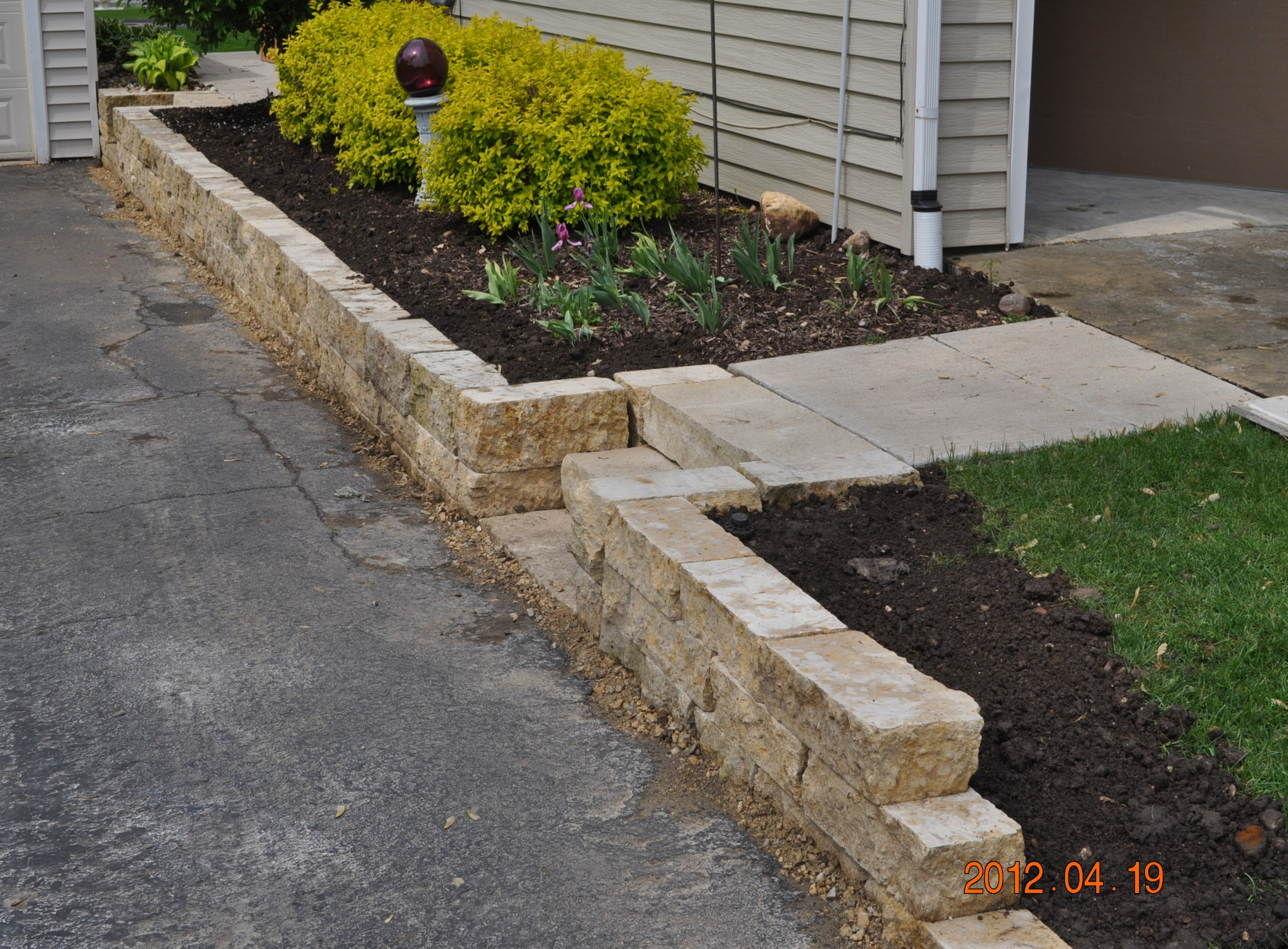 Small retaining walls like this one help to create raised landscaping features.