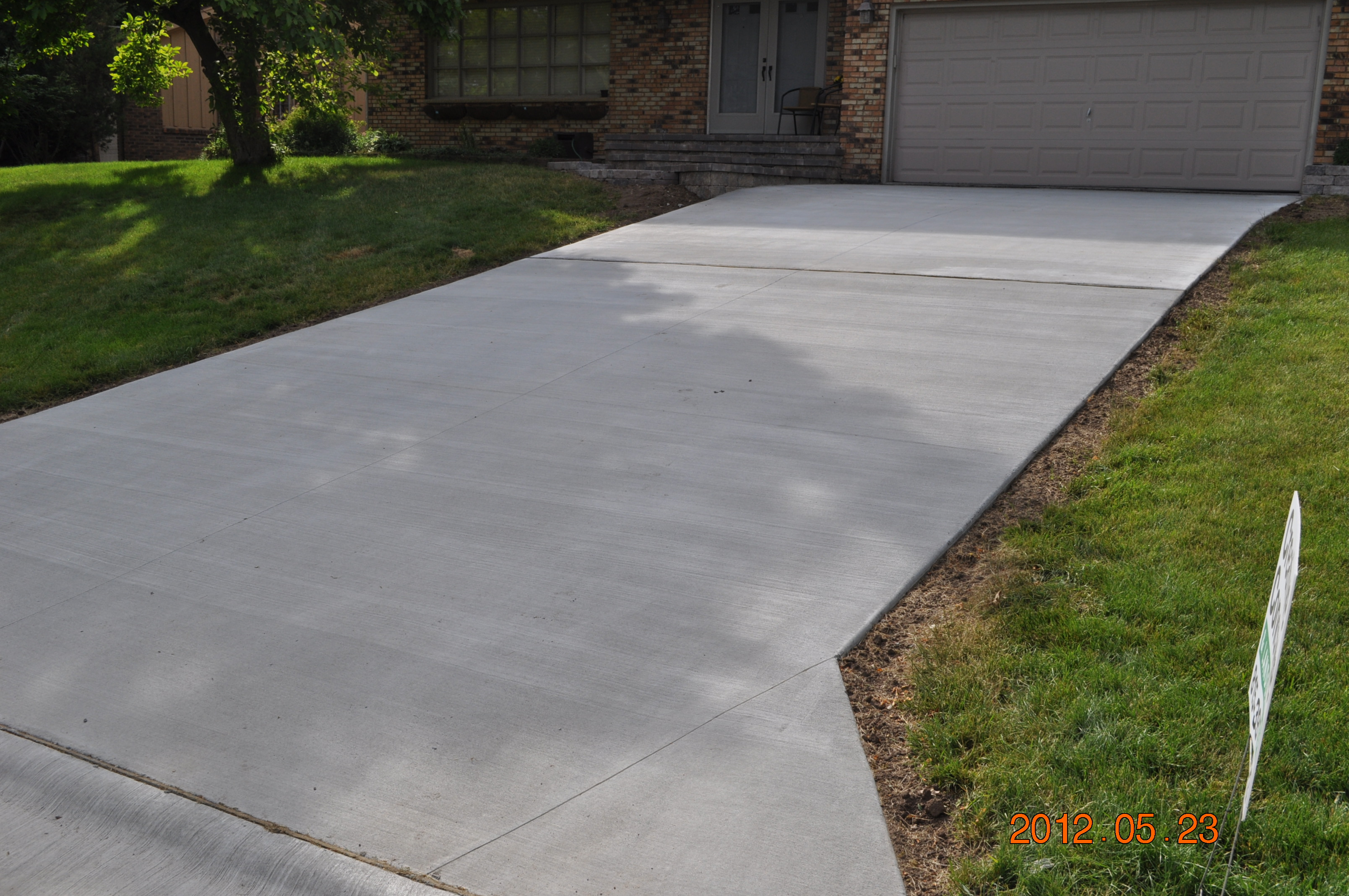 Rockford driveways stamped concrete brick paver for Pouring concrete driveway