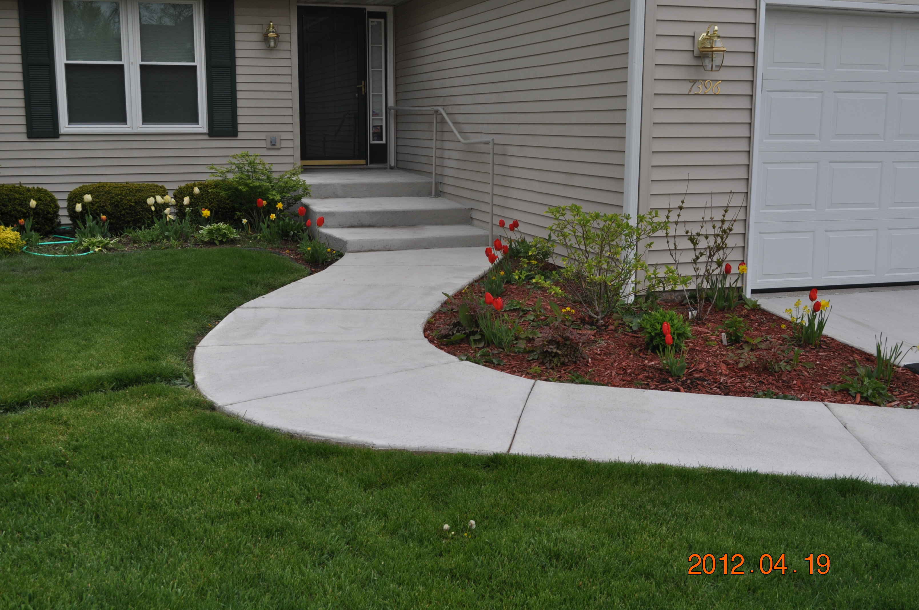 Poured concrete features like this walkway are also a great choice